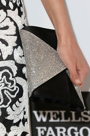 Nina Dobrev stuck to the black and white look at Elton John's Oscar party with this black satin and crystal envelope clutch.