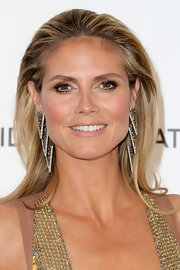 Heidi Klum kept her look on the statement side of natural with look-at-me mauve-tinged lips.