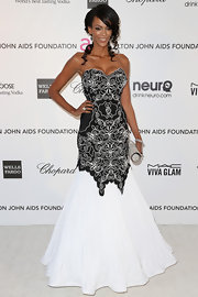 Judi Shekoni looked classic and elegant at Elton John's Oscar party with a black and white mermaid gown with swirl designs on the body.