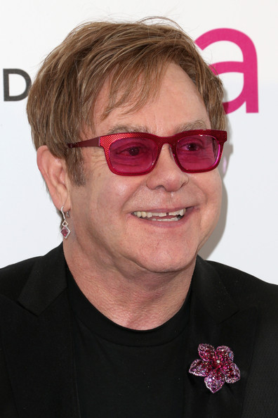More Pics of Elton John Dangling Gemstone Earrings (1 of 16) - Dangle Earrings Lookbook - StyleBistro [eyewear,hair,face,glasses,pink,chin,vision care,forehead,sunglasses,wrinkle,arrivals,elton john,california,los angeles,elton john aids foundation,oscar viewing party]