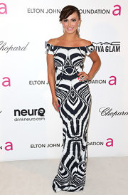Karina Smirnoff added some spice to her Oscar night look with a black and white off-the-shoulder gown.