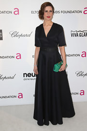 Livia Firth channeled old Hollywood with a classic black belted gown.