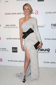 Petra Nemcova chose a one-shoulder dress with front slit for her evening look.