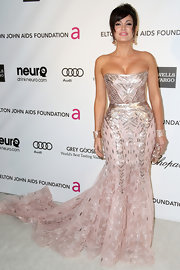 Bleona Qereti opted for a pink and silver strapless gown for her evening-look at Elton John's Oscar party.