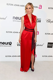 Radha Mitchell opted for a bright red gown with two-toned sash around the waist for her Oscar-party look.