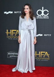 Angelina Jolie looked supremely elegant in a silver wrap gown by Jenny Packham at the Hollywood Film Awards.
