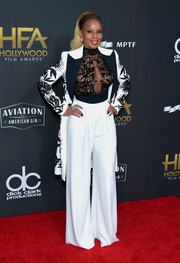 Mary J. Blige turned heads in her Zuhair Murad Couture ensemble, consisting of an embroidered coat, a matching sheer top, and wide-leg trousers, at the Hollywood Film Awards.