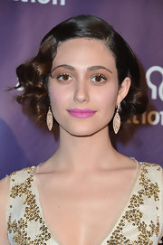 Emmy Rossum wore a pair of Art Deco-inspired dangle earrings to top off her retro look.
