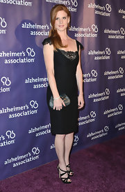 Sarah Rafferty chose an elegant LBD with lace capped-sleeves and a lace neckline for her red carpet look.