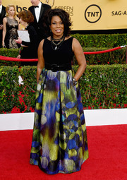 Lorraine Toussaint cut a vibrant figure at the SAG Awards in a Theia gown with a painterly skirt.
