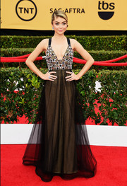 Sarah Hyland looked very mature and glamorous at the SAG Awards in a Vera Wang gown boasting a jewel-adorned bodice, a plunging neckline, and a tulle-overlay skirt.