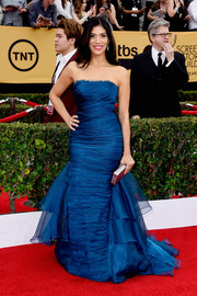 Laura Gomez chose a frothy blue strapless gown by Theia for her SAG Awards look.
