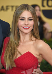 Sofia Vergara achieved a sexy pout thanks to a bold red lipstick hue.