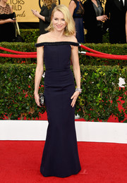 Naomi Watts kept it modern and sophisticated at the SAG Awards in a navy Balenciaga column dress with micro-beaded off-the-shoulder straps.
