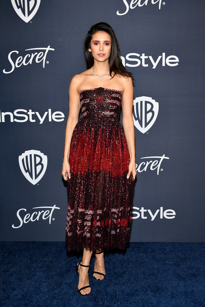 Nina Dobrev cut a chic figure in a strapless Dior dress in various shades of red at the Warner Bros. and InStyle Golden Globes after-party.