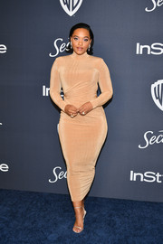 Kiersey Clemons flaunted her curves in a form-fitting beige dress by JLUXLABEL at the 2020 Warner Bros. and InStyle Golden Globe afterparty.