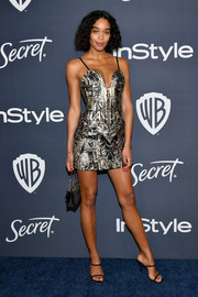 Laura Harrier teamed her frock with barely-there heels by Giuseppe Zanotti.