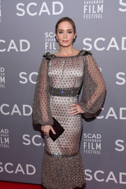 Emily Blunt paired a dark plum velvet clutch by Jimmy Choo with a beaded gray dress for the SCAD Savannah Film Festival opening night.