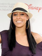 Tia Mowry topped off her casual look with large gold hoop earrings.