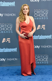 Anna Chlumsky went sultry in a low-cut burnt-orange halter gown by Halston Heritage for her Critics' Choice Awards look.