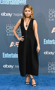 Sarah Hyland sealed off her all-black look with cross-strap sandals by Giuseppe Zanotti.