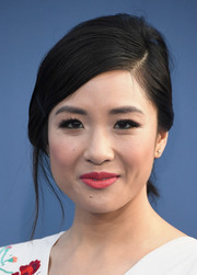 Constance Wu kept her beauty look sweet with a swipe of pink lipstick.
