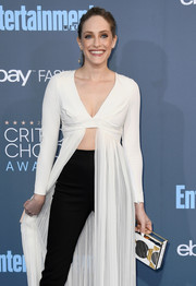 Carly Chaikin accessorized with a futuristic Naeem Khan box clutch at the Critics' Choice Awards.