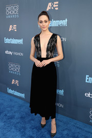 Emmy Rossum was bold and elegant at the Critics' Choice Awards in an ankle-length Giorgio Armani dress with a beaded bodice and a plunging neckline.