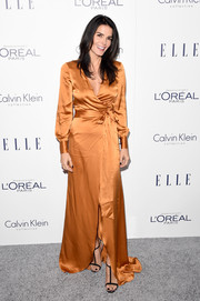 Angie Harmon went for classic glamour in a floor-length rust-colored wrap dress when she attended the Elle Women in Hollywood Awards.