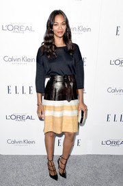 Zoe Saldana paired her sweater with a stylish tricolor skirt, also by Calvin Klein.