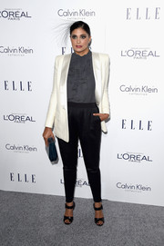 Rachel Roy layered a white tux jacket over a gray ruffle blouse for her Elle Women in Hollywood Awards look.