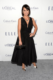 Constance Zimmer styled her dress with a pair of crystal-encrusted T-strap pumps.