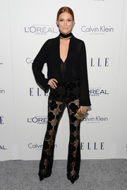 Darby Stanchfield styled her outfit with a glam gold clutch.