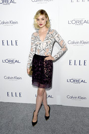 Bella Heathcote showed off her slim figure in a tight-fitting leaf-print top by Thakoon at the Elle Women in Hollywood Awards.