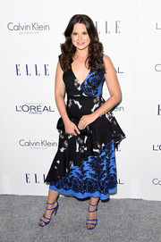 Katie Lowes cut a girly figure in a mixed-print peplum dress by Tracy Reese during the Elle Women in Hollywood Awards.