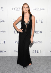 Teresa Palmer went for edgy glamour in a leather-trimmed black maxi dress by Calvin Klein during the Elle Women in Hollywood Awards.