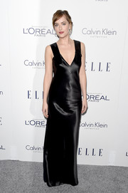 Dakota Johnson was boudoir-glam in a clingy black gown by Calvin Klein during the Elle Women in Hollywood Awards.