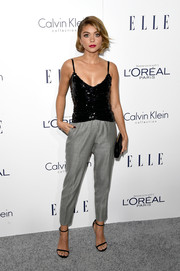 Sarah Hyland balanced out her sexy top with masculine-chic pants by Armani, featuring a micro-houndstooth print.