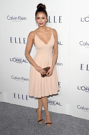 Nina Dobrev was super sexy and sophisticated in a cleavage-baring nude slip dress by Calvin Klein at the Elle Women in Hollywood Awards.