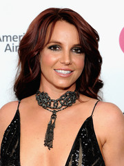 Britney Spears wore her hair down in high-volume waves during the Elton John AIDS Foundation Oscar viewing party.