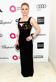 Anna Paquin looked sultry at the Elton John AIDS Foundation Oscar viewing party in a figure-hugging Alexander McQueen dress with a cleavage cutout.