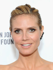 Heidi Klum's braided updo at the Elton John AIDS Foundation Oscar viewing party had an edgy feel.