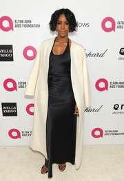 Kelly Rowland tamed her slinky gown with a simple white coat during the Elton John AIDS Foundation Oscar viewing party.