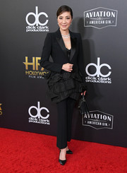 Michelle Yeoh attended the 2018 Hollywood Film Awards wearing a ruffle-accented tuxedo.