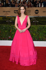 Emilia Clarke went for a Barbie-at-the-ball vibe with this plunging hot-pink Dior Haute Couture gown at the SAG Awards.