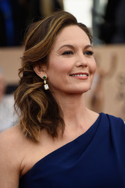 Diane Lane glammed up her look with this wavy side sweep for the SAG Awards.