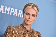 Charlize Theron accessorized with a gold sequined headband to match her dress at the 2020 Costume Designers Guild Awards.