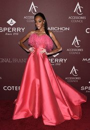 Winnie Harlow looked striking in a strapless pink Alexis Mabille Couture gown with a feathered neckline at the 2019 ACE Awards.