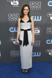 Alexis Bledel went modern in a bluish-gray Rasario gown with a contrast belt and shoulder straps at the 2018 Critics' Choice Awards.