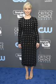 Emilia Clarke completed her look with gold ankle-strap sandals.